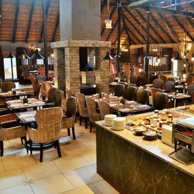 Various seating options for dining in the Restaurant at Mabula Game Lodge.