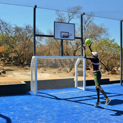 Enjoy basketball with friends on the multi-functional court.